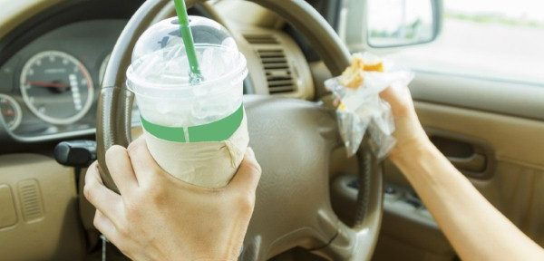 Don't ignore dangers of eating at the wheel (image credit: iStock/JK1991)