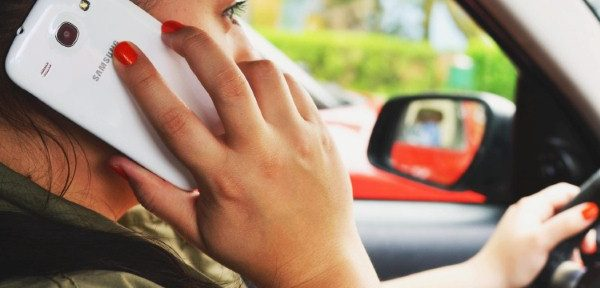 Women more likely to use their phone behind the wheel than men
