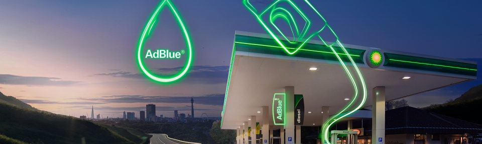 photo of a BP garage with a green silhouette of a fuel pump