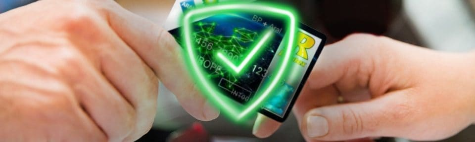 a photo of a hand passing a BP fuel card to another hand. A green shield with a tick is placed onto of the image to symbolise the card is protected