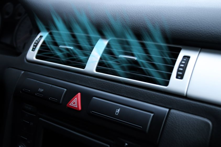 Air condition on car dashboard with graphics indicating cold air blowing