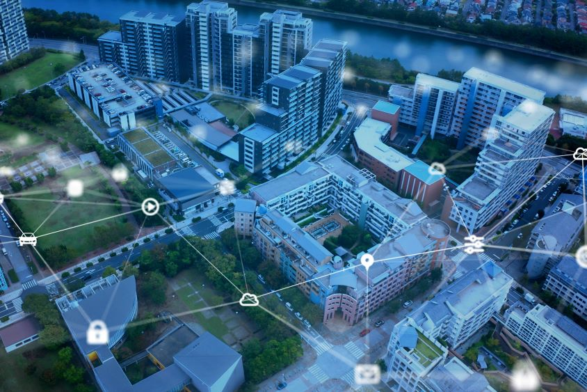 Aerial view of city with graphics to indicate connectivity and tracking