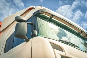 Close up of white HGV exterior on sunny day