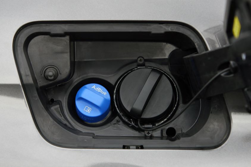 Fuel inlet with adblue plug