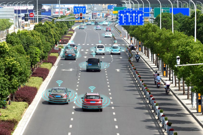 Road of cars with blue graphics to indicate connectivity