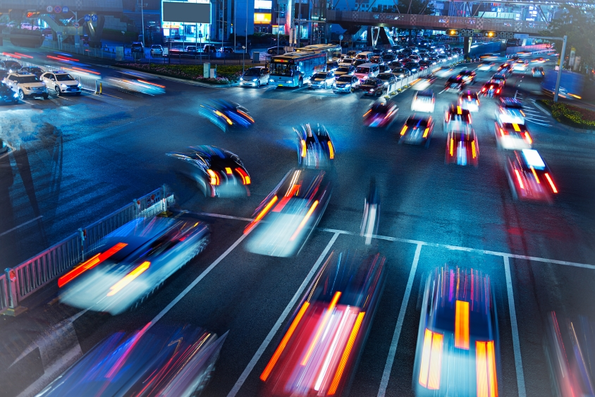 Long exposure image of traffic driving through a city at night