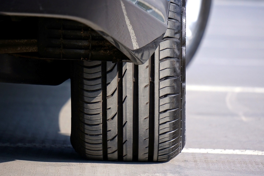 Shot of a tire on the back wheel of a car