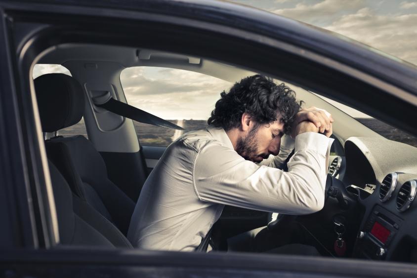 Man in car asleep at the wheel