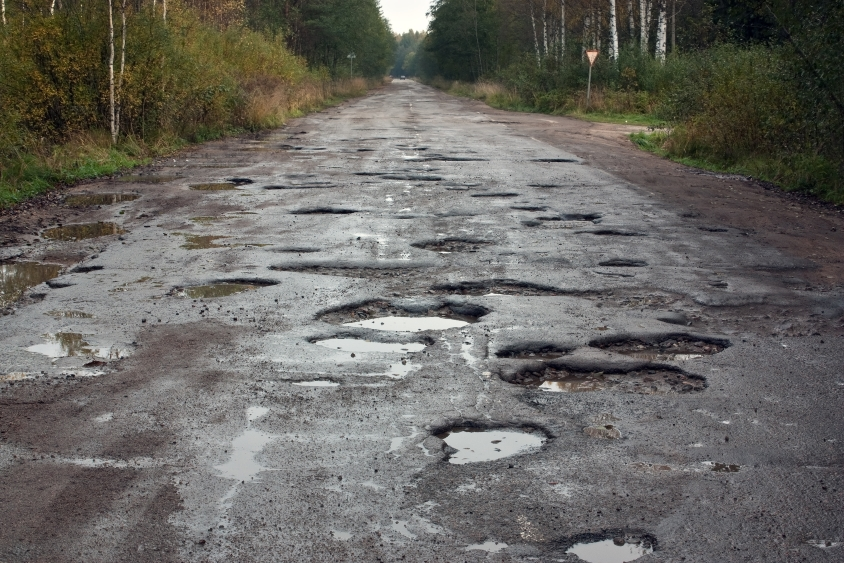 Long road covered in potholes