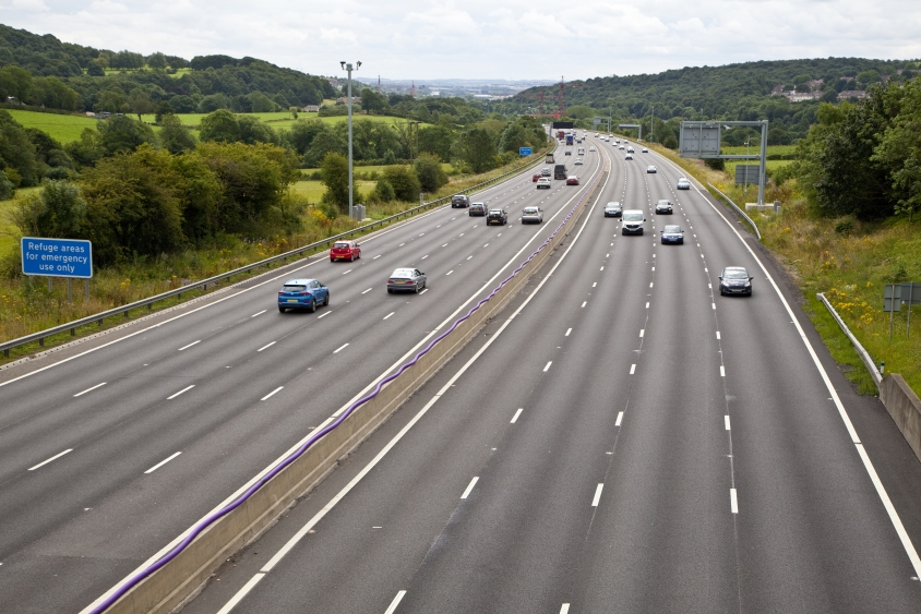 Aerial shot of a smart motorway with four lanes open on each side