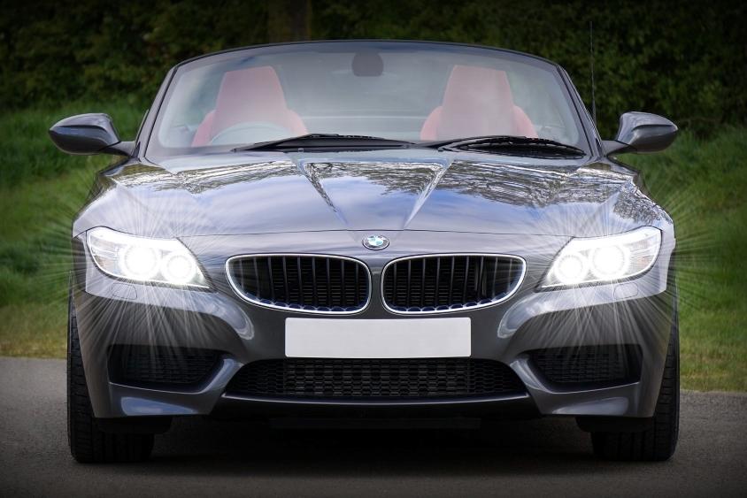 Grey BMW car with headlights on