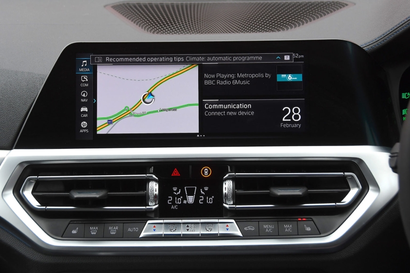 Satnav and entertainment system on car dashboard
