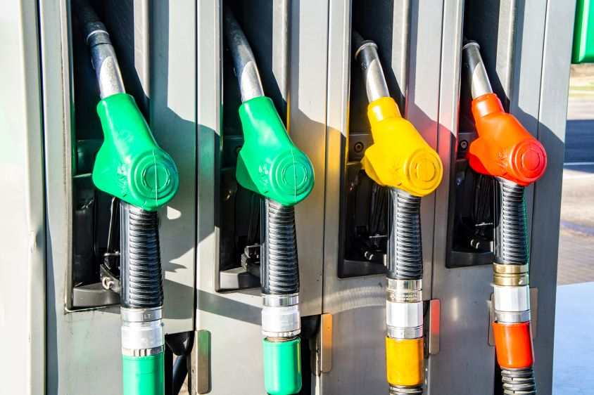 Colourful fuel pumps in holders