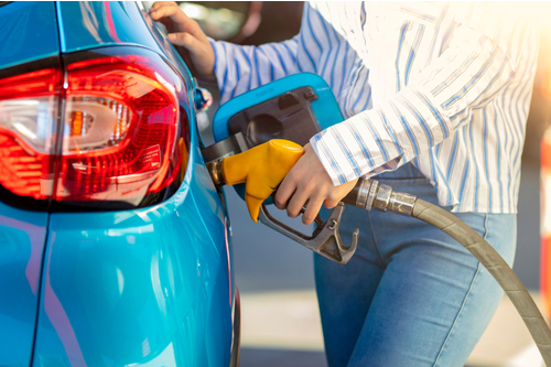 Person filling up car with fuel