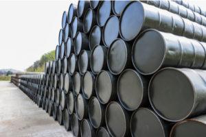 Image of several barrels of crude oil lined up