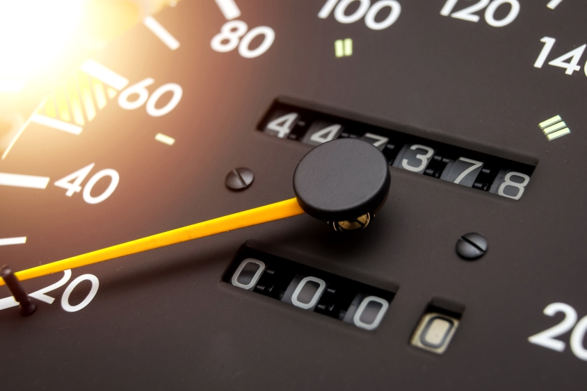 Close up of a car speedometer and odometer