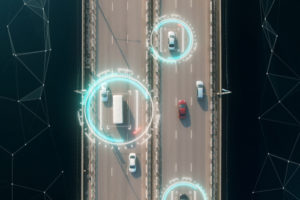 Aerial view of cars on motorway with data overlay