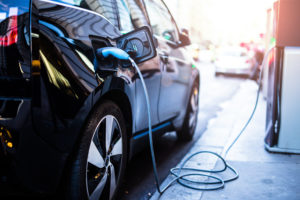Plug-in electric car being charged at on-street charging point