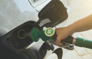 Closeup of petrol nozzle showing 95 octane label