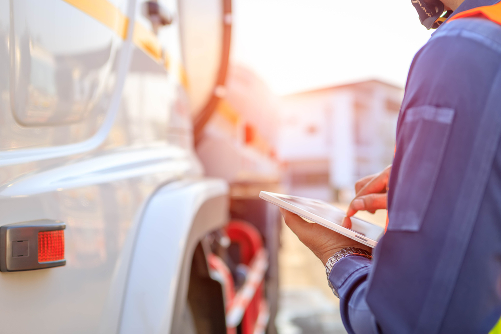 Truck Drivers Hand Holding Tablet Checking Stock Photo