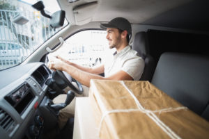 Van driver making delivery with parcels on seat