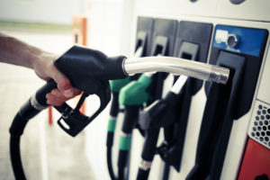 Close up of hand holding a fuel pump at filling station