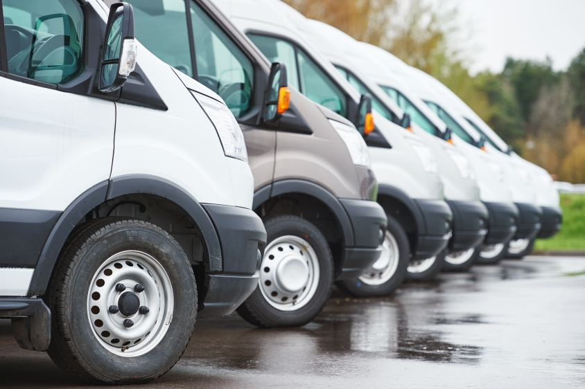 Close-up of a row of parked commercial vans