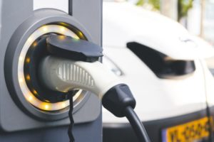 Electric vehicle charging point next to a parked white van