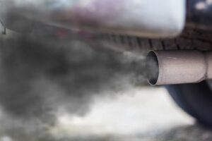 A cloud of exhaust fumes being emitted by a car.