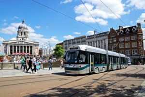 A tram passing the City Hall in Nottingham, UK