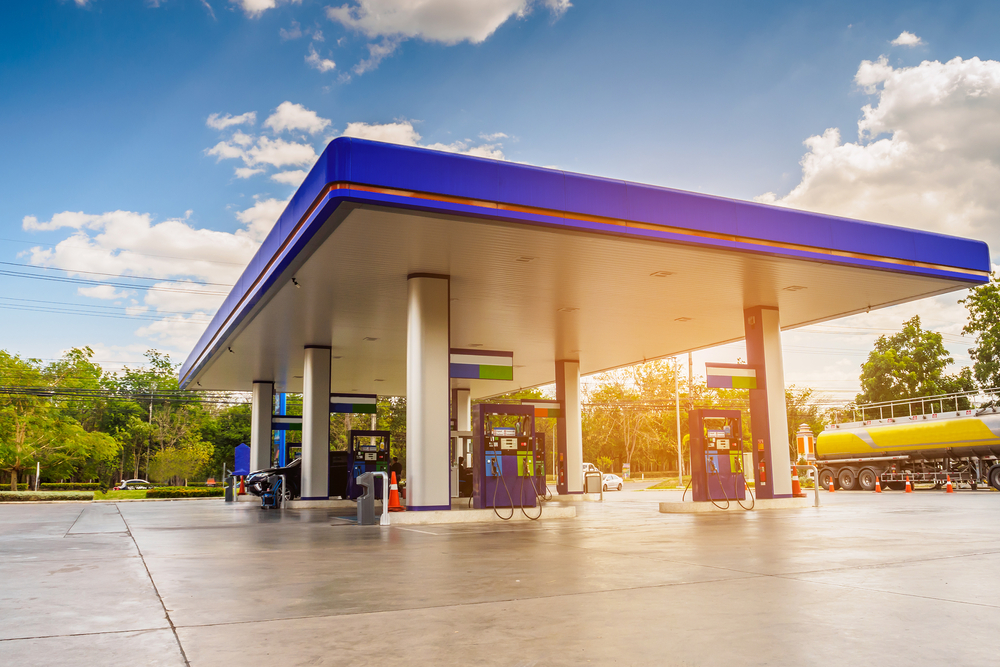 A picture of a petrol station against a sunny sky