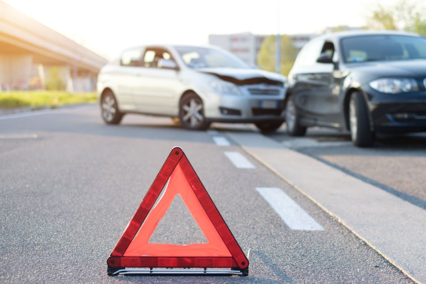Warning triangle placed on road at scene of accident