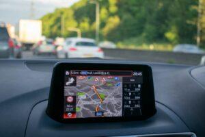 GPS navigation system on car dashboard showing roadworks