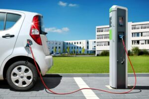 Electric car recharging in front of office buildings
