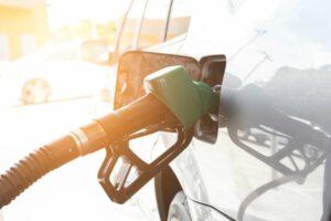Green fuel nozzle in white car