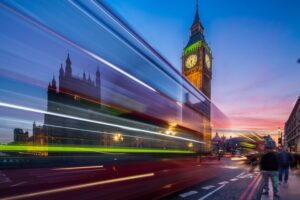 London street with Big Ben in background, long exposure of vehicles driving past