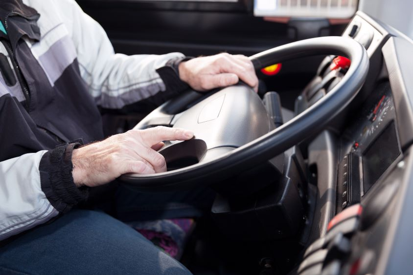 Driver's hands on wheel of HGV