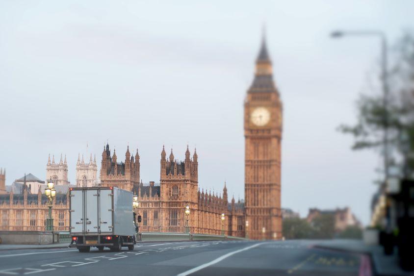 Lorry driving over bridge towards Big Ben, London