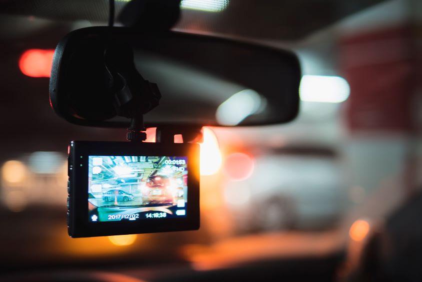 Dash cam in interior of vehicle at night