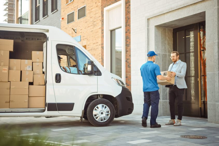 Man delivering package from delivery van