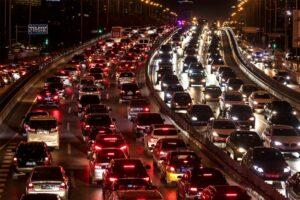 Cars driving in motorway traffic at night