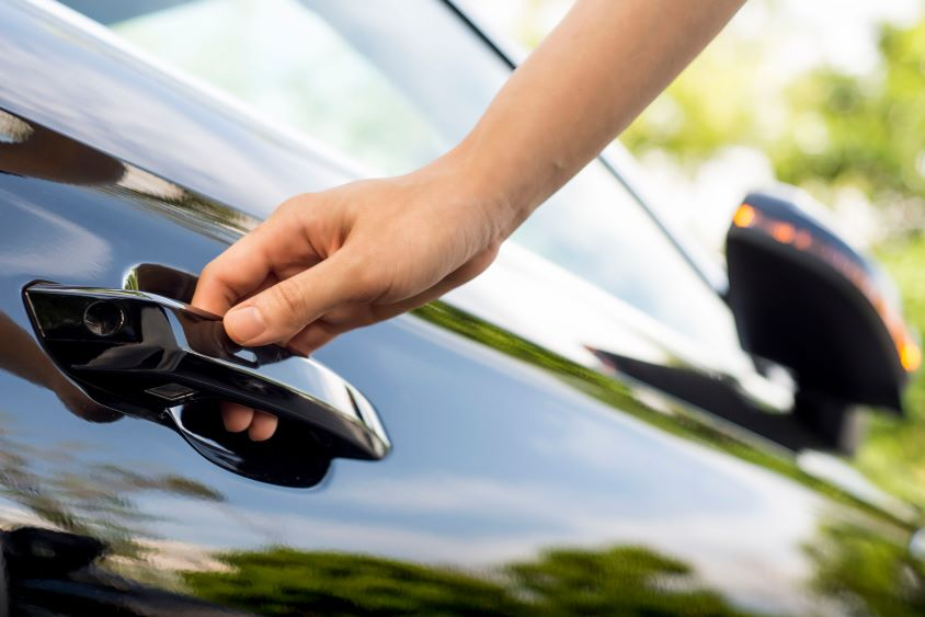 Hand on car door handle