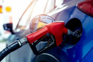 Red fuel nozzle in blue car