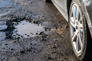 Car wheel avoiding small pothole