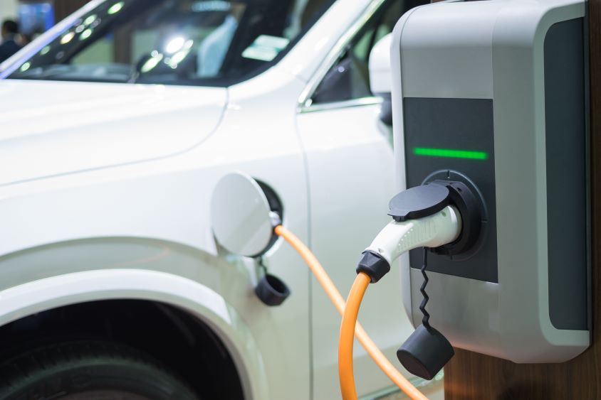 Electric charge point, charging a white electric car