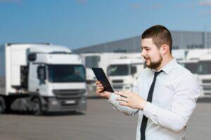 Man managing fleet on tablet