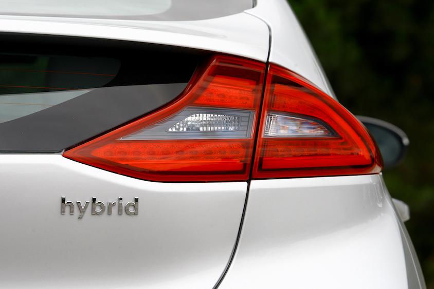 Back of white hybrid car